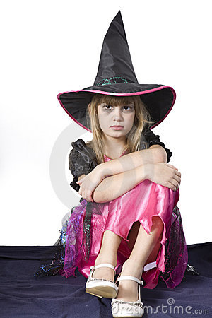 Little cute angry girl in carnival fancy dress on