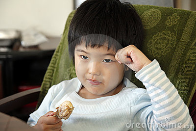 Little cute asian girl eating