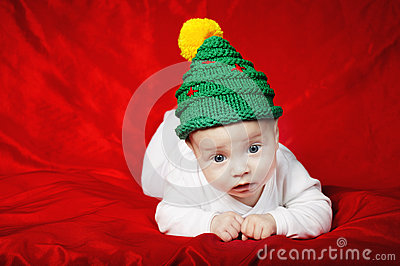 Little cute baby with christmas tree hat