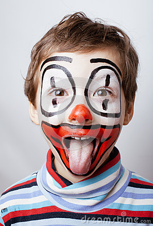 Little cute boy with facepaint like clown