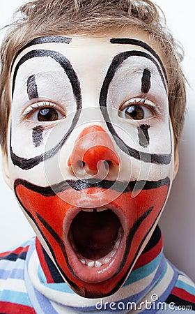Little cute boy with facepaint like clown