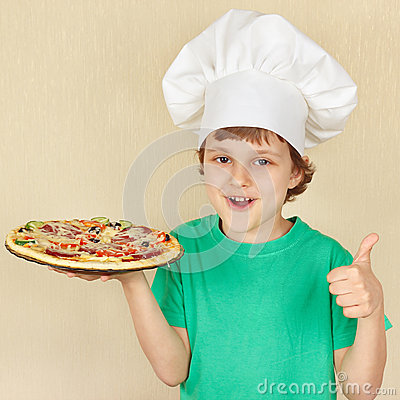 Free Little Cute Boy In Chefs Hat With Cooked Appetizing Pizza Stock Photo - 53584850