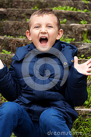 Little cute boy screaming