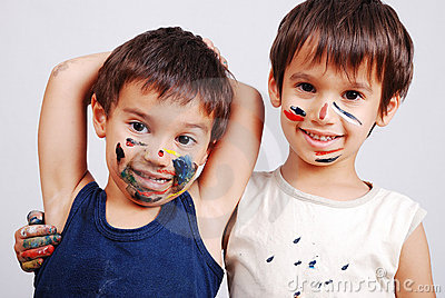 A little cute brothers with colors on their face