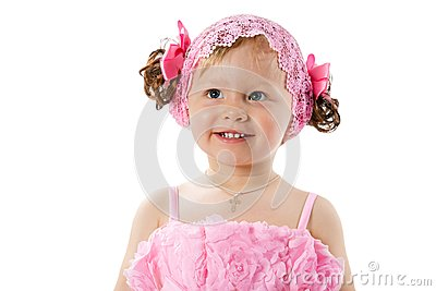 Little cute child girl with with pink bows isolated on white background.