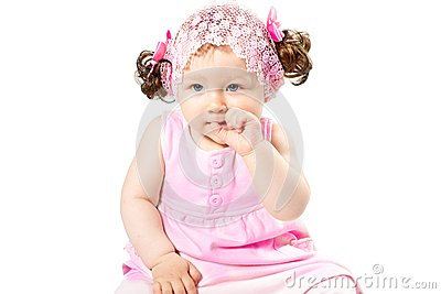 Little cute child girl in pink dress isolated on white background.