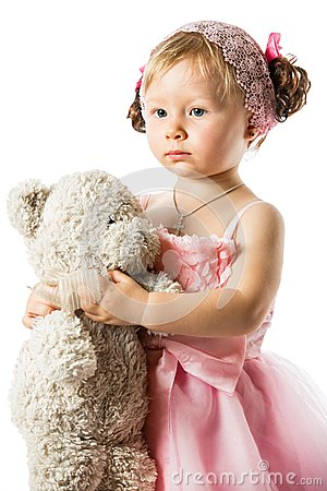 Little cute child girl with teddy bear isolated