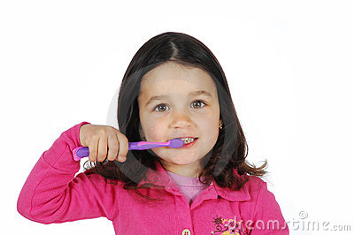 Little cute girl brushing the teeth