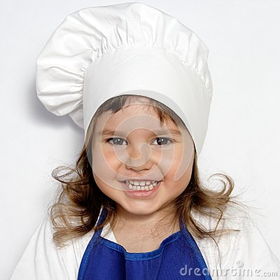 Little Cute Girl in Cook s Cap Portrait