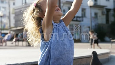 Little Cute Girl Feeding Street Pigeons In The Park At ...