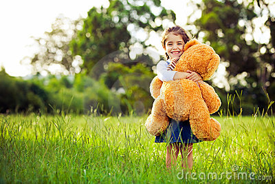Little cute girl holding teddy bear