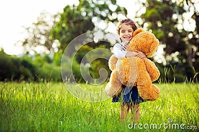 Little cute girl holding teddy bear