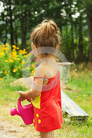 Free Little Cute Girl Playing With Plant Watering Can Stock Photos - 47989023