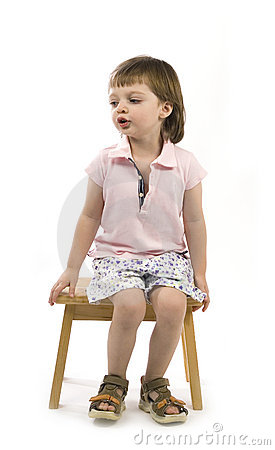 Little cute girl sitting on a chair