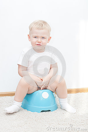 Little cute smiling boy on potty