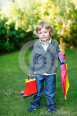 Free Little Cute Toddler Boy With Colorful Umbrella And Boots, Outdoo Stock Images - 32960624