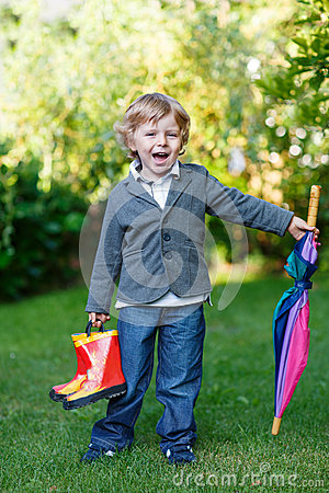 Free Little Cute Toddler Boy With Colorful Umbrella And Boots, Outdoo Royalty Free Stock Image - 32960636