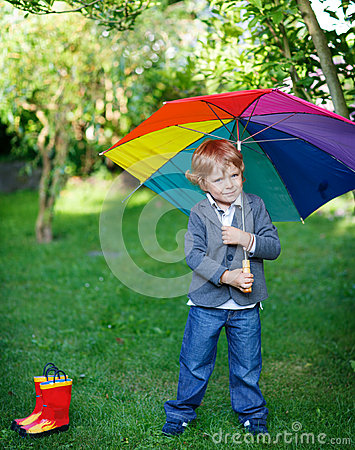 Free Little Cute Toddler Boy With Colorful Umbrella And Boots, Outdoo Stock Images - 33180994