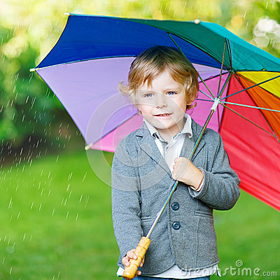 Free Little Cute Toddler Boy With Colorful Umbrella And Boots, Outdoo Royalty Free Stock Images - 55635569