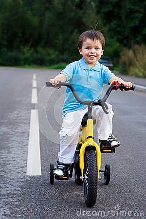 A little cyclist on the tour on the road