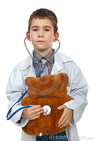 Little doctor examine bear toy