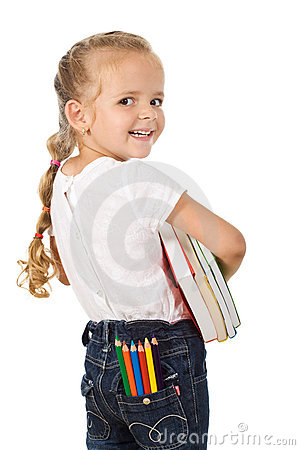 Little excited girl preparing to go back to school