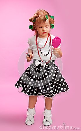 Little fashion-conscious girl, just like mother