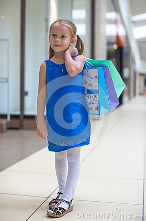 Little fashion girl with packages in large