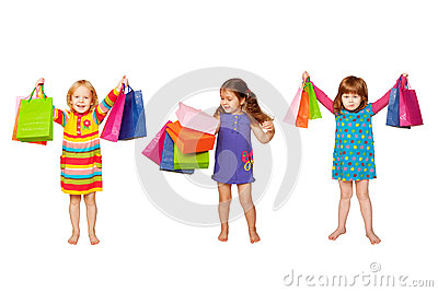 Little fashion girls with shopping bags
