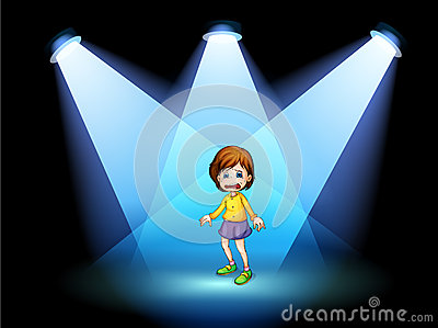 A little girl acting at the center of the stage