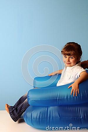 Little girl on air armchair