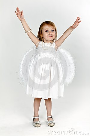 Little girl with angel wings in the studio