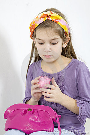 Little girl applying make-up with powder-puff