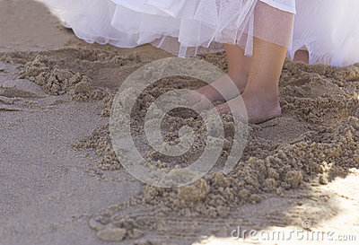 Bridesmaid feet in the sand