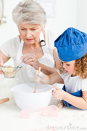 A Little Girl  Baking With Her Grandmother Stock Photos - Image: 18109263