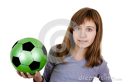 A little girl with the ball