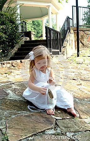 Little Girl and Ballet Slippers
