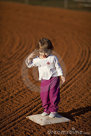 Little girl on basball field