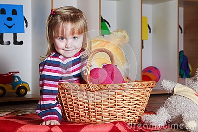 Little girl with basket playing