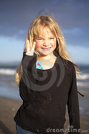 Little girl on beach at sunset