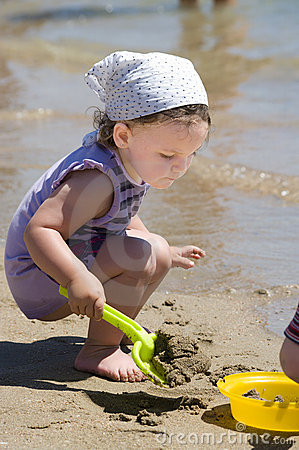 Little girl with beach toys