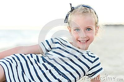 Little girl on beach vacation.