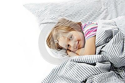 Little girl in the bedroom