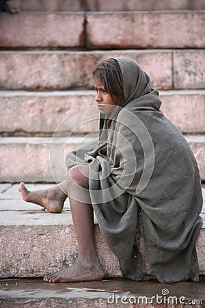 Little girl begger sitting on stairs,Vanarasi Editorial Stock Image