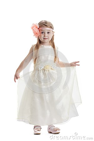 Little girl in beige dress