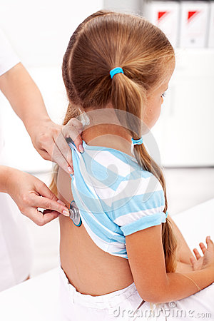 Little girl being checked at the doctor