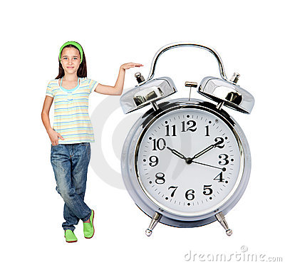 Little girl with a big alarm clock