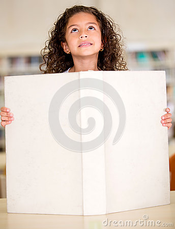 Little girl with a big book