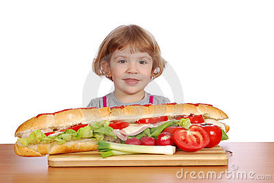 Little girl with big sandwich
