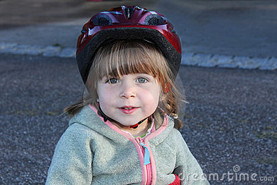 Little girl with biking helmet